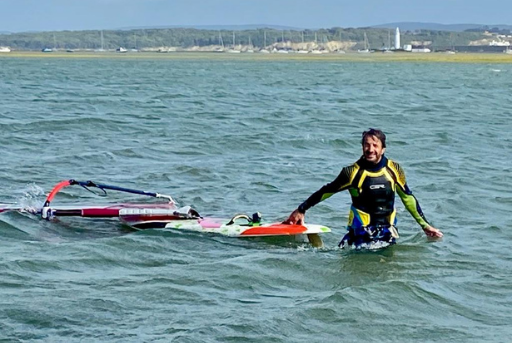 Tom in water with windsurfer
